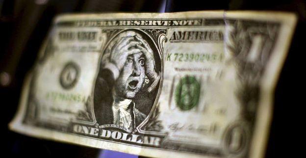dollar_und_hande_vor_dem_kopf.jpg